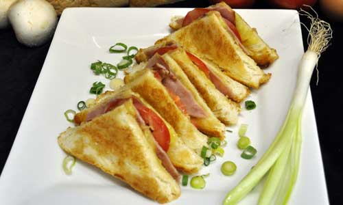 Ham, Cheese, and Tomato Toasted Sandwich